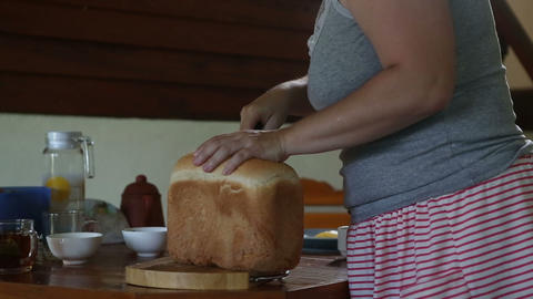 woman cuts off white bread crust Footage