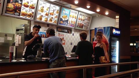 People ordering food inside KFC store Footage