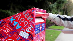 Woman Placing Mail In A Canadian Mail Box stock footage