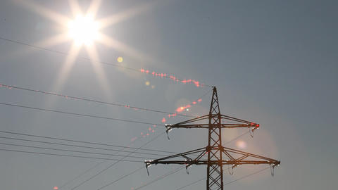 Still shot of sun shining on electricity cables wi Footage