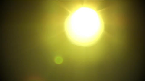 Strong yellow-green light with lens flare and came Footage