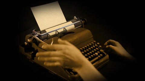 writing on shining typewriter in sepia Live Action