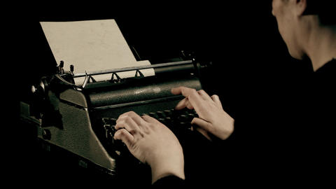 a man writing on a typewriter Live Action
