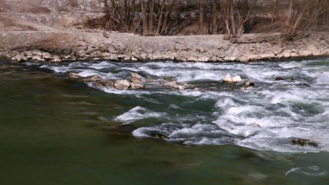 River running across rocks Footage