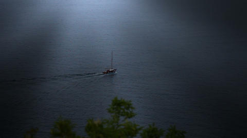 sailing boat in the sunset taken from the hill Live Action