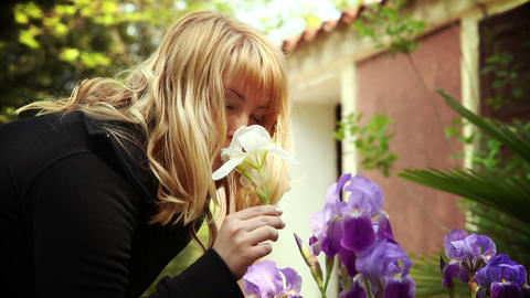 Woman Smelling Flowers stock footage
