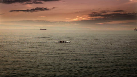 team rowing in the boat on the sea with time laps  Live Action