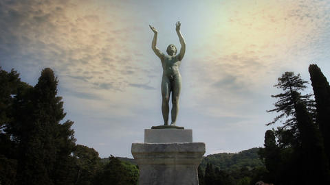 a statue of a naked man Live Action