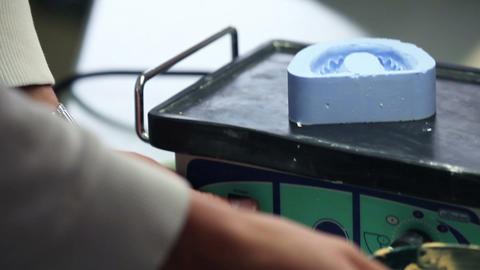 Dentist prepares mass for creation the teeth Footage