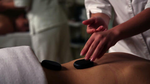 Maser out massage with stones Footage