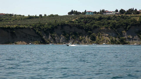 Shot of the shore near Piran from the moving boat  Footage