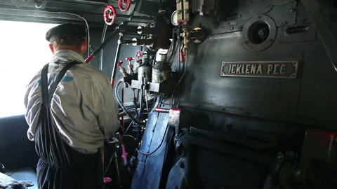 the stoker on a steam engine driving the train Stock Video Footage