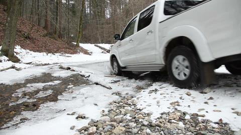 an all terrain vehicle driving through a small riv Footage