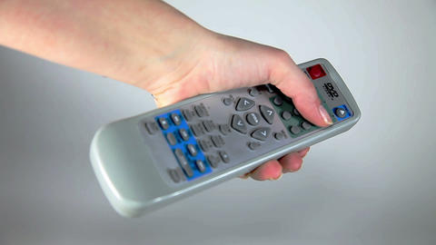 Close up shot of a hand holding remote Live Action