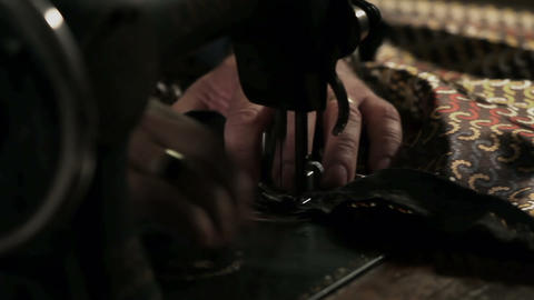 Close up shot of a tailor behind a sewing machine Live Action
