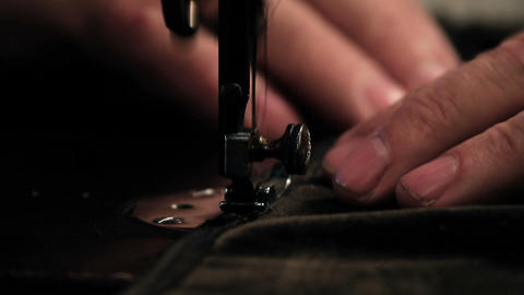 Close up shot of a tailors hands sewing a dress Live Action