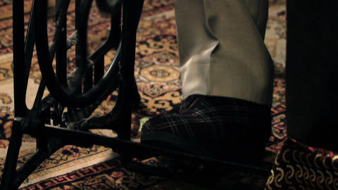 Close up shot of tailor`s legs pushing a sewing ma Stock Video Footage