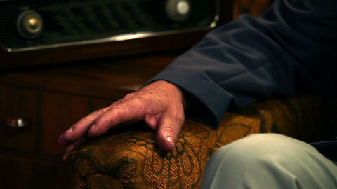 Close up shot of a tailors hand relaxing on a chai Footage