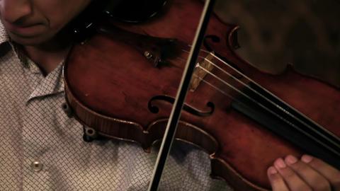Close up pan shot of a violin player Live Action