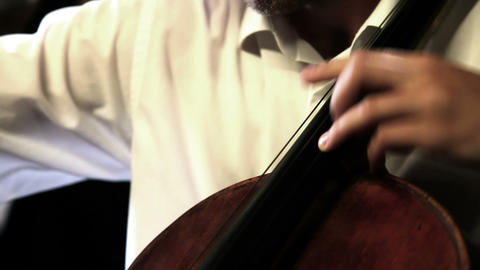 Close up pan shot of a cello player Live Action