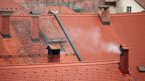 Still shot of smoking chimney on roof Live Action