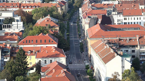 Ljubljana city buildings and street full of cars Live Action