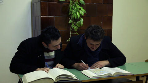 Two students studying in an old classroom Footage