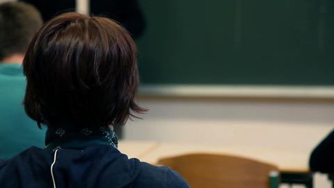 Female student in classroom asking a question Footage