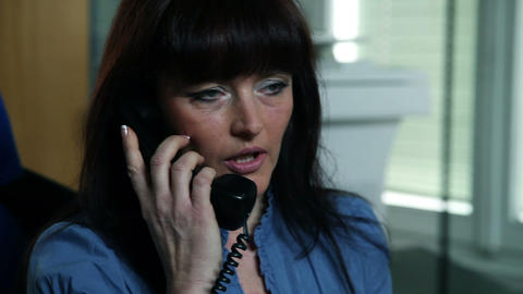 Woman talking on the telephone Footage