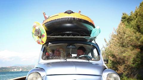 Big Family Stuffed In A Small Car Having Fun stock footage
