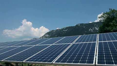 Solar Panels With Mountains In The Background stock footage