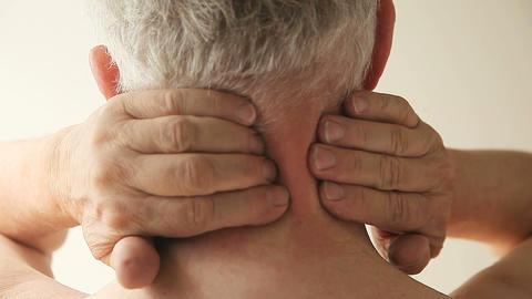 man massages his sore neck Footage