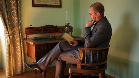 Young Businessman Reading A Book In An Old Fahione stock footage