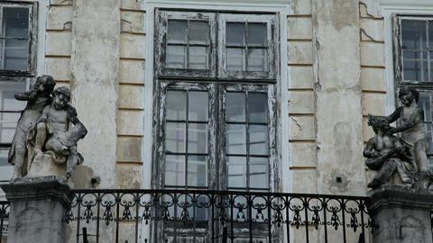 balcony with sculptures and broken glass doors Footage