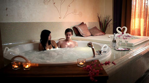 Couple enjoying in private jacuzzi Live Action
