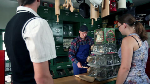 Young people buying in old retro shop Live Action