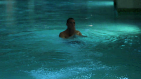 Man jump in swimming pool Live Action