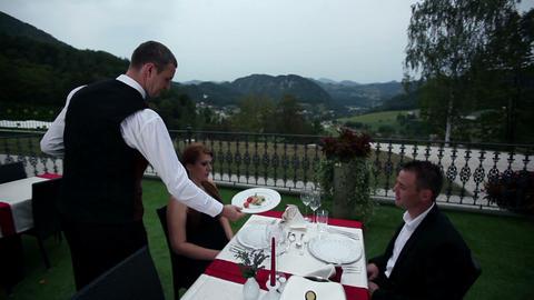 waiter served dinner to lovely couple who celebrat Footage