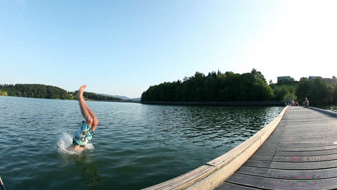 Jumping And Wimming In The Lake Low Angle Shot stock footage