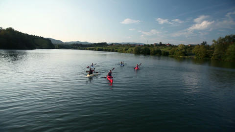Young people in distance canoeing on sunny day Footage