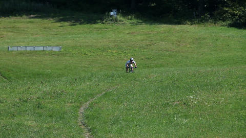Young, sporting man fastly riding a bike downhill Footage