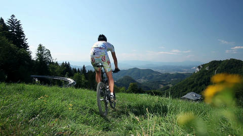 Young, sporting man riding bike on sunny day Footage