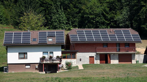 New and old house equiped with solar panels Footage