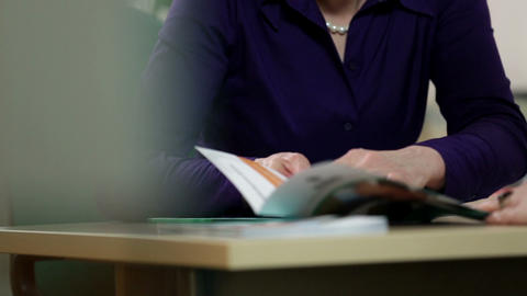 Low Angle Close Up Of Employee Showing Brochure To stock footage