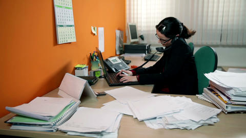 Business woman having a lot of work in office, mak Footage