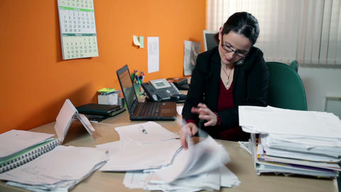 Business woman in office on the phone searching fo Footage
