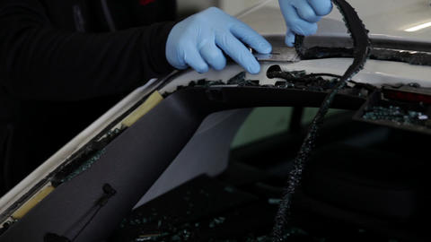 Professional Removing Windshield Glass From Car stock footage