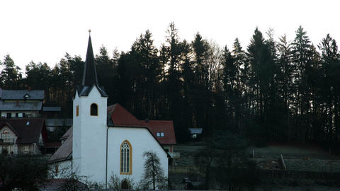 church in small village on a hill with sunrise Footage