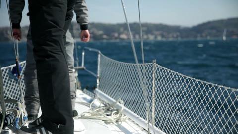 Details of excited men preparing for sailing regat Footage