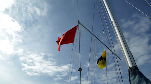 Different flags on sailboats in the harbor Footage